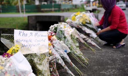 Flowers Line Up At Tragedy Site